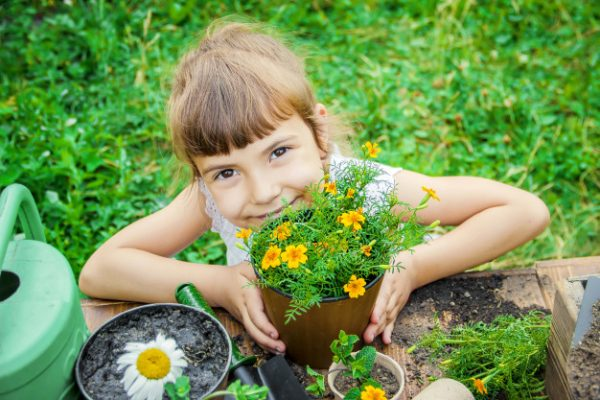 Awesome Kids' Garden Projects: Spend More Time with Your Kids girl with flowers